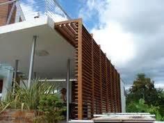 Brise-soleil de façade / en bois / orientable DUCOSLIDE