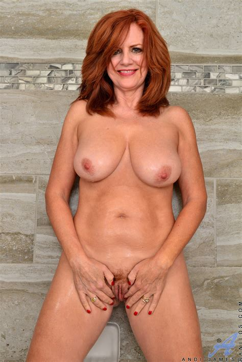 busty redhead andi james soaps up her pussy during nude modeling debut