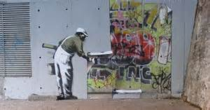 famous bansky mural painted over by rival street artist in