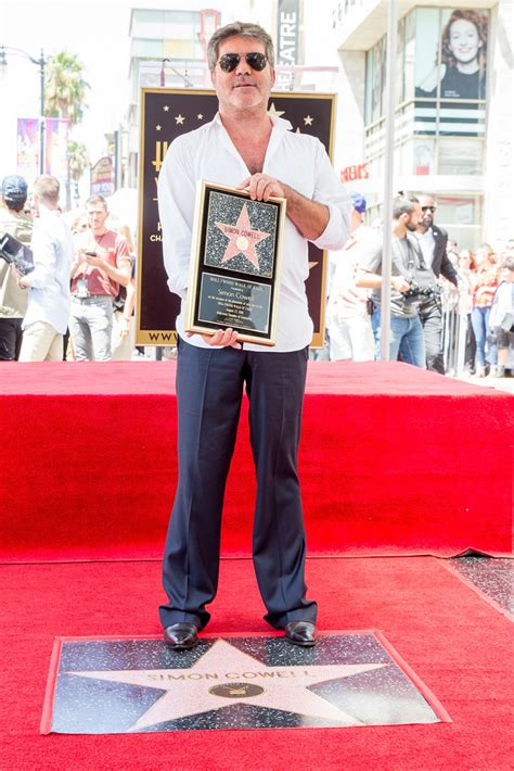 Simon Cowell Honored With Star The Hollywood Walk