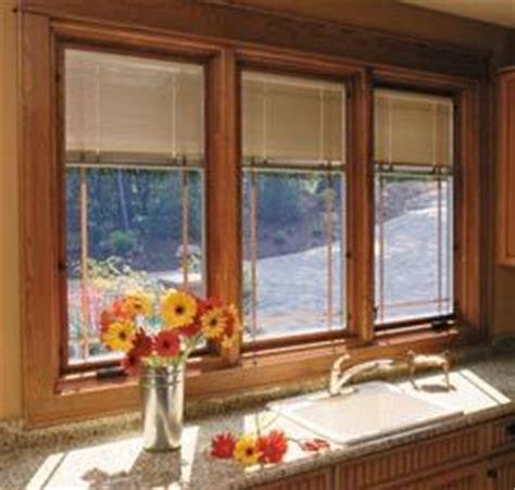 window treatments  casement windows pella designer series blinds  shades protected