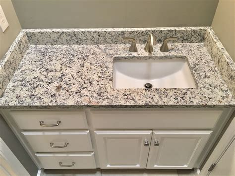granite countertop with sink ashen white granite countertops moen 8 quot widespread faucet