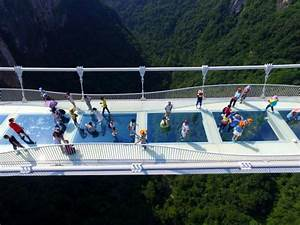 World's highest glass-bottomed bridge opens in China ...