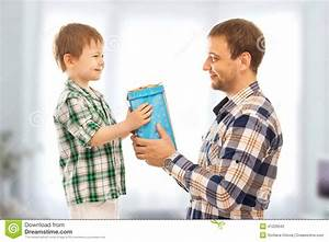 Happy Son Gives His Father Gift. Stock Photo - Image: 41220642