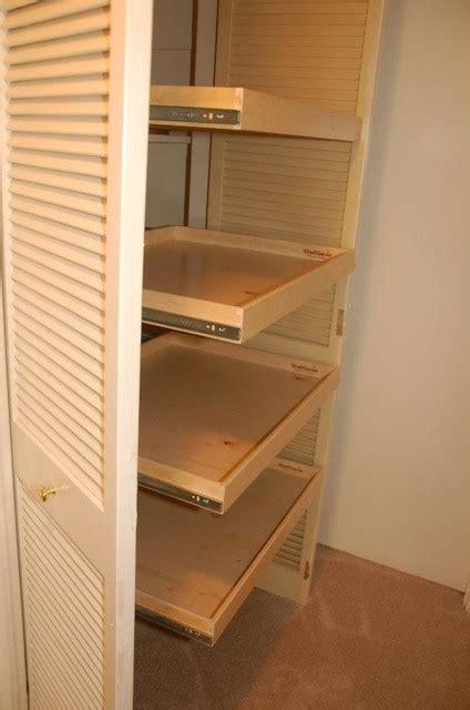 Linen Closet Shelving Systems by Linen Closet Roll Out Shelves Closet Organizers