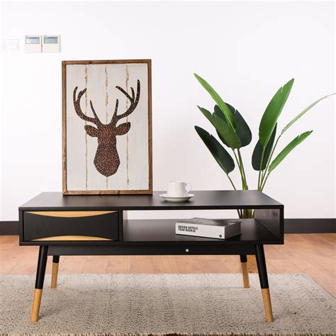 Consider one with an unexpected silhouette. Lovelle Coffee Table | Coffee table with storage, Round coffee table modern, Modern coffee tables