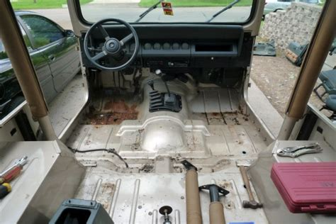 jeep xj floor pan removal prepping the interior for herculiner jurassic jeep 65