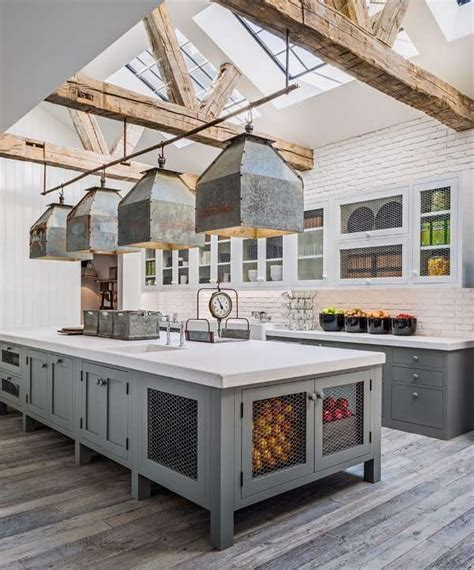 large farmhouse kitchen  gray cabinets  modern industrial pendant lights farmhouse
