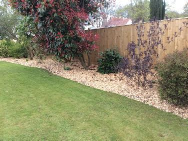 using bark chippings in garden bark mulch and wood chip delivery in surrey west sussex