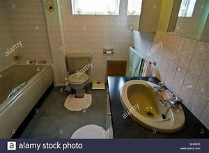 horizontal wide angle interior of an old fashioned 8039s With old coloured bathroom suites