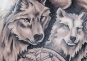 Black Wolf with Blue Eyes Tattoos