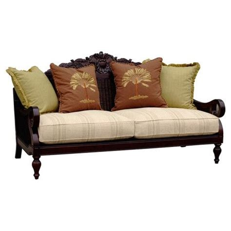 wood sofa with paneling and striped cushion seat