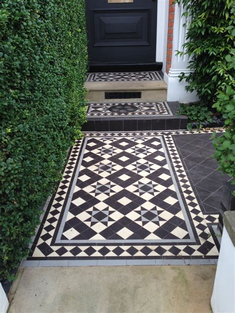 black and white tessellated front patio tiles in photos
