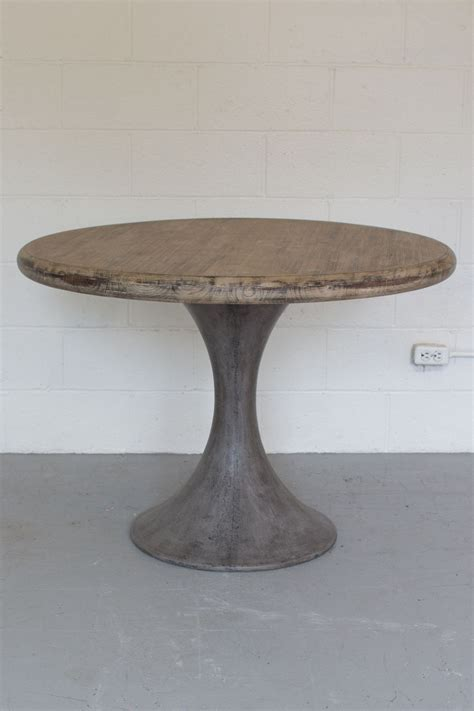 Pairing a Solid Concrete Pedestal Base and Round Acacia