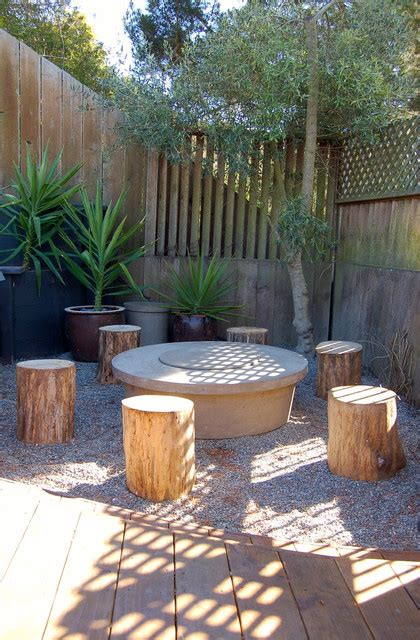 small fire pit  tree stump stools
