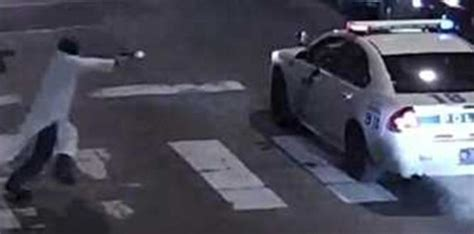 nypd officer ambushed killed  sitting  patrol car