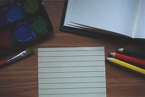 Black Wooden Pencil on Graphing Paper · Free Stock Photo