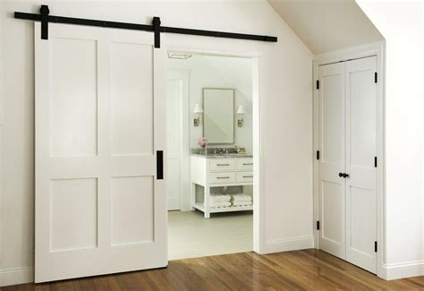 en suite bathroom  barn door  rails transitional