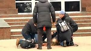 Woman shot as crowds storm Ukrainian regional security ...