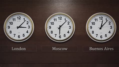 wall clocks showing time zones fly stock footage video