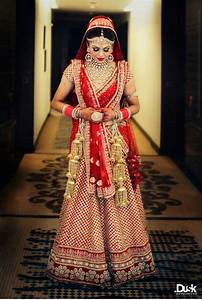 Sabyasachi red and gold bridal outfit indian wedding for Punjabi wedding dresses online