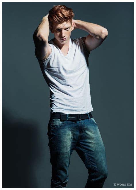 daniel ferreira poses    shirt jeans  wong sim