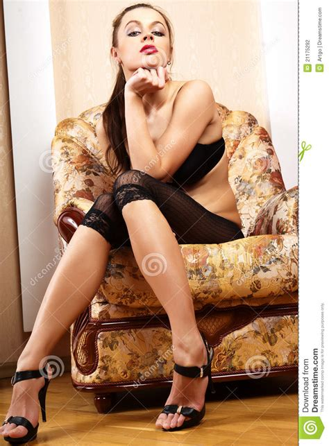 Sexy girls sitting in a chair