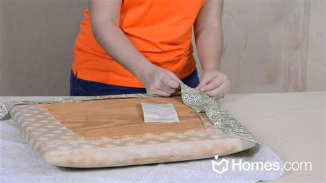 How To Recover A Chair Seat Cushion by Homes Com Diy Experts Share How To Recover A Chair Cushion