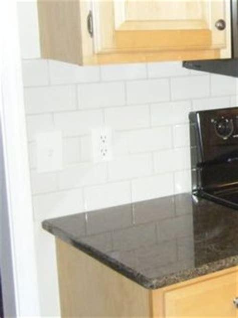 should you line your kitchen cabinets where do you end a kitchen backsplash designed