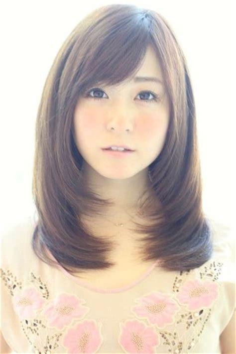 medium side swept bangs womens hairstyles curly hair