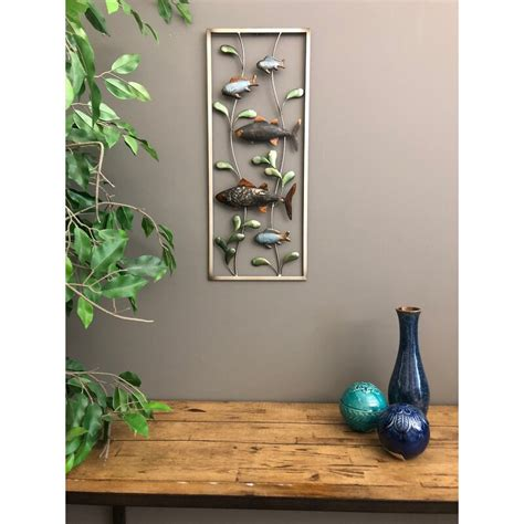This is one big wall so we had plenty of room to fill up! Highland Dunes Metal 3 Dimensional Fish Wall Décor & Reviews | Wayfair