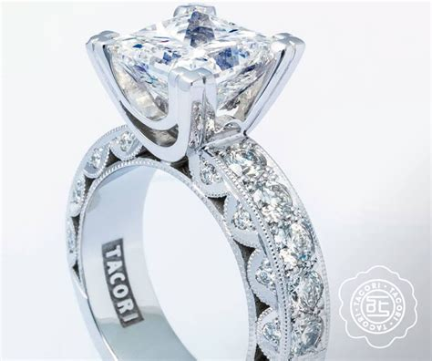 a classic engagement ring with modern tacori crescent