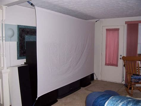 diy projector screen   bed sheets  bungee cord