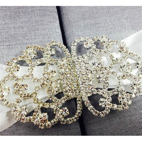 large rhinestone silver covered sweet silver silk covered gate fold invitation with a large