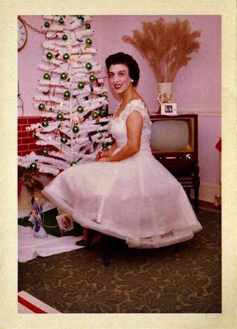 mid century women enjoying aluminum christmas trees
