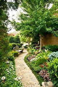 Lush Outdoor Oasis With Flagstone Walkway and Waterfall