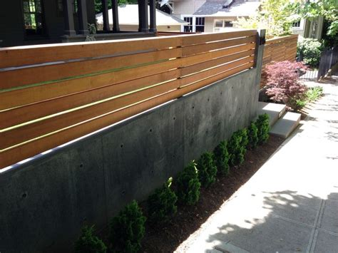 Wood Fence On Top Of Concrete Retaining Wall