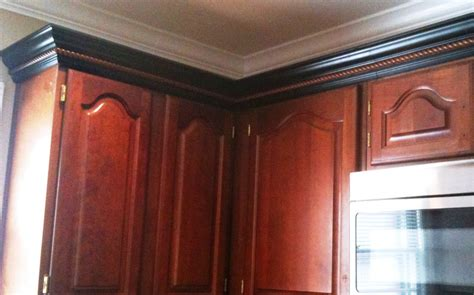 installing crown molding on kitchen cabinets cherry cabinets black molding black crown molding 8992