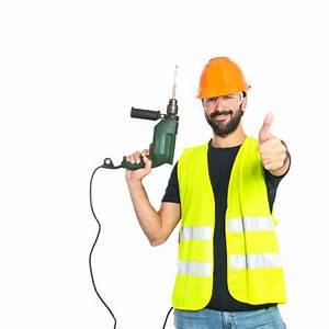 Workman with drill over white background Photo Free Download