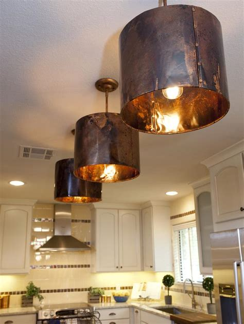 copper pendants in a mediterranean kitchen designers