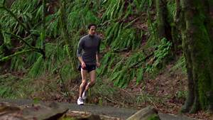 A man runs through the woods in slow motion - HD stock ...