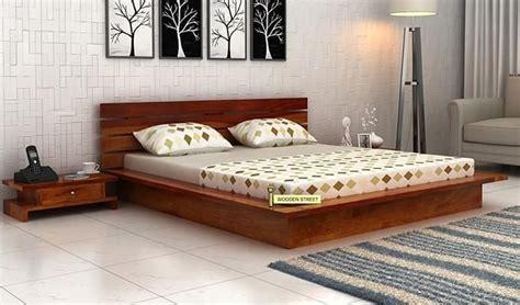 buy dwayne  floor platform bed king size honey finish