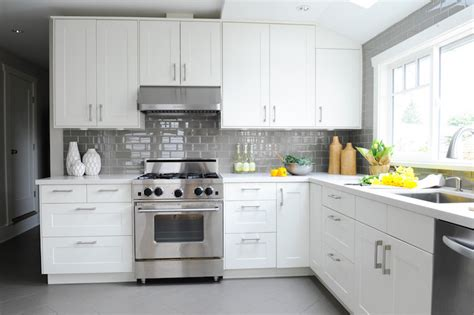 white kitchens  cool toned accents