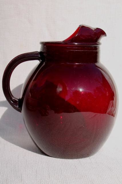 vintage ruby red glass pitcher, ball jug shape water or