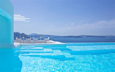 santorini oia greece canaves pool hotel hotels infinity resort summer travel expedia gr resorts luxury suites restaurant today islands courtesy