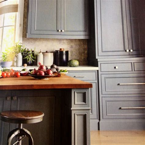 gray wood kitchen cabinets grey kitchen cabinets against light wood floor this