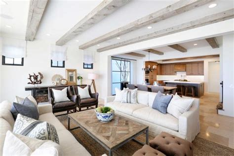 neutral beach home  exposed beams rustic elements blackband design hgtv