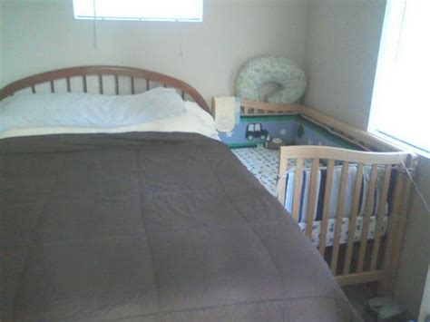 Side Crib Attached To Bed by Turning An Ordinary Drop Side Crib Into A Sidecar Co