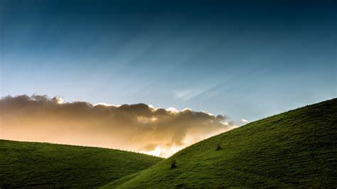 nature landscape clouds hills grass sun rays fence