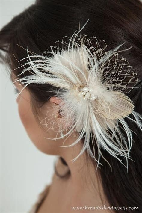 chagne and ivory feather peacock birdcage fascinator
